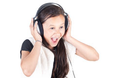 Happy young girl with headphones Royalty Free Stock Photos