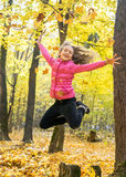 Happy young girl in high jump Stock Photography