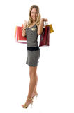 Happy Young girl holding bags Royalty Free Stock Photo