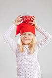 Happy young girl holding big cup on head Royalty Free Stock Photos