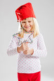 Happy young girl holding Christmas star decoration Stock Photo