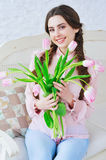Happy young girl holding flowers Stock Image