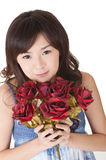 Happy young girl holding roses Stock Photography