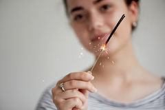 Happy young girl holding a Sparkler.The atmosphere of the festival. Happy young girl holding a Sparkler. The atmosphere of the festival Stock Image