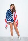 Happy young girl holding USA in bikini Royalty Free Stock Photos