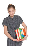 Happy young girl holds books Royalty Free Stock Photography