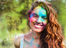 Happy young girl on holi color festival Stock Photos