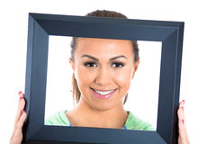 Happy young girl inside of picture frame Royalty Free Stock Photography