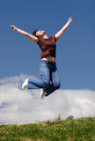 Happy young girl jump Stock Image