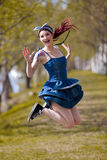 Happy young girl jumping Royalty Free Stock Image