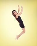 Happy young girl jumping with a short dress Royalty Free Stock Photos