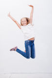 Happy young girl jumping  on white background Royalty Free Stock Photos