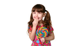 Happy Young Girl Laughing Holding Lollipop. On White Background Royalty Free Stock Images