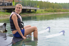 Happy young girl learning on water ski Royalty Free Stock Photos