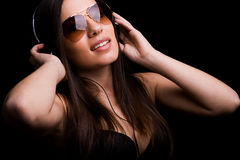 Happy young girl listening music Stock Image