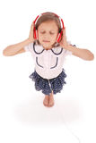 Happy young girl listening to music, view from above Stock Photo