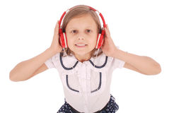 Happy young girl listening to music, view from above Royalty Free Stock Images