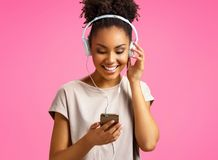 Happy young girl listens music in headphones. stock photography
