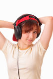 Happy young girl listens to music on headphones Royalty Free Stock Photography
