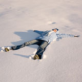 Happy young girl  lying in the. Snow Royalty Free Stock Photos