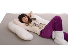 Happy young girl lying on pillow Royalty Free Stock Image