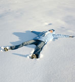 Happy young girl lying in the snow Stock Image