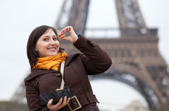 Happy young girl with macaroons in Paris Royalty Free Stock Images
