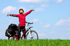 Happy young girl on mountain bike. In the meadow Royalty Free Stock Photo