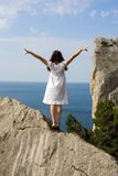 Happy Young Girl On The Rocks Stock Photography