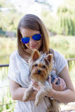 Happy young girl owner with yorkshire terrier dog Stock Image
