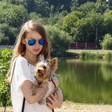 Happy young girl owner with yorkshire terrier dog Royalty Free Stock Photo