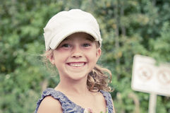 Happy young girl in the park smiling Stock Photos