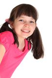 Happy young girl with pigtails. Portrait of happy young girl with pigtails isolated on white background Royalty Free Stock Photo
