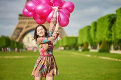 Happy young girl with pink balloons in Paris Royalty Free Stock Images