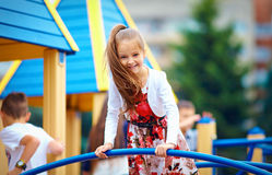 Happy young girl playing on outdoor playground Stock Photography