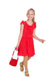 Happy young girl with a purse Royalty Free Stock Photography