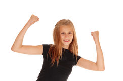 Happy young girl raising her arms. Stock Image