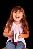 Happy young girl with red book smile and dreaming Royalty Free Stock Images