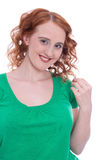 Happy young girl with red hair isolated on white Royalty Free Stock Images