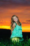 Happy young girl rest on green field Royalty Free Stock Photo