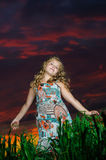 Happy young girl rest on green field Royalty Free Stock Image