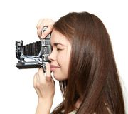 Young girl and retro camera. Happy young girl and retro camera. Hobby Royalty Free Stock Images