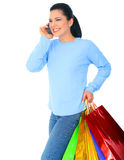 Happy Young Girl Shopping. Shopping girl walking and talking. isolated on white stock photography