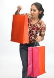 Happy young girl with shopping bags Stock Photo