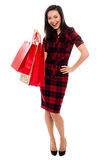 Happy young girl with shopping bags royalty free stock images