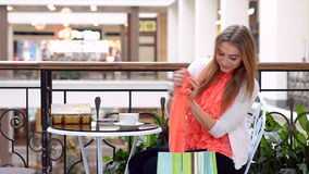 Happy young girl with shopping bags in the shopping mall. stock video footage