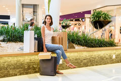 Happy Young Girl With Shopping Bags In Shopping Mall Royalty Free Stock Photos