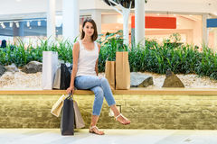 Happy Young Girl With Shopping Bags In Shopping Mall Royalty Free Stock Images