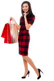 Happy young girl with shopping bags Stock Photography