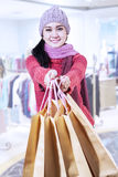 Happy young girl in shopping center Royalty Free Stock Photography
